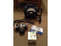 Olympus film camera with lens, film and case