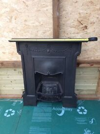 Cast iron open fire place with shelf