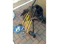 Full set of junior golf clubs irons , woods, golf bag and trolly .