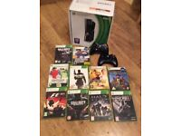 Boxed Xbox 360 with power pack, leads, 2 wireless controllers and 10 games