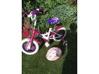 Girls first two wheel bike with stabilisers .Great condition