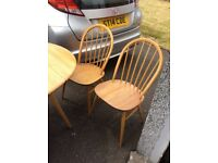 Ercol drop leaf dining table and 4 chairs. Design 384. Light finish.