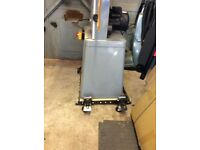 Trade rated Bandsaw, mounted on mobile base. Complete with four new saw blades £900 ono
