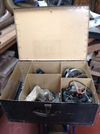 Metal storage box with bits and bobs.