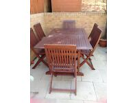 Hardwood garden table with 6 chairs