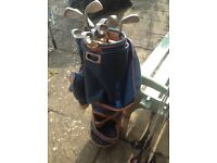 Ladies set of golf clubs and trolley bag