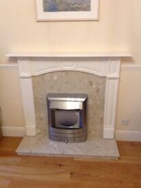 Electric fire and marble/MDF surround.