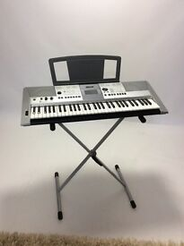 Yamaha keyboard with adjustable stand in excellent condition, bought as a gift,only used few times.