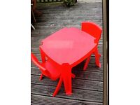 Childs table and 2 chairs. Red with star design
