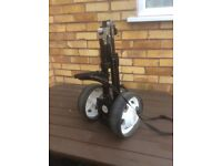 Very Compact golf trolley fold up type with removable wheels .