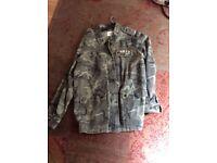 Ladies coat size 16....never worn...papaya weekend make..size 16.never worn size 16 army style.