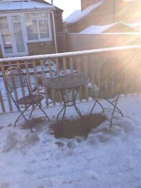 Metal table and folding chairs