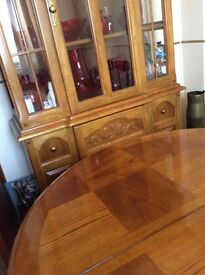 Solid oak dining table,six chairs and Dutch dresser