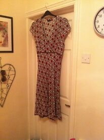 Size 18 papaya dress A line from under bust, knee lenth. Only worn once