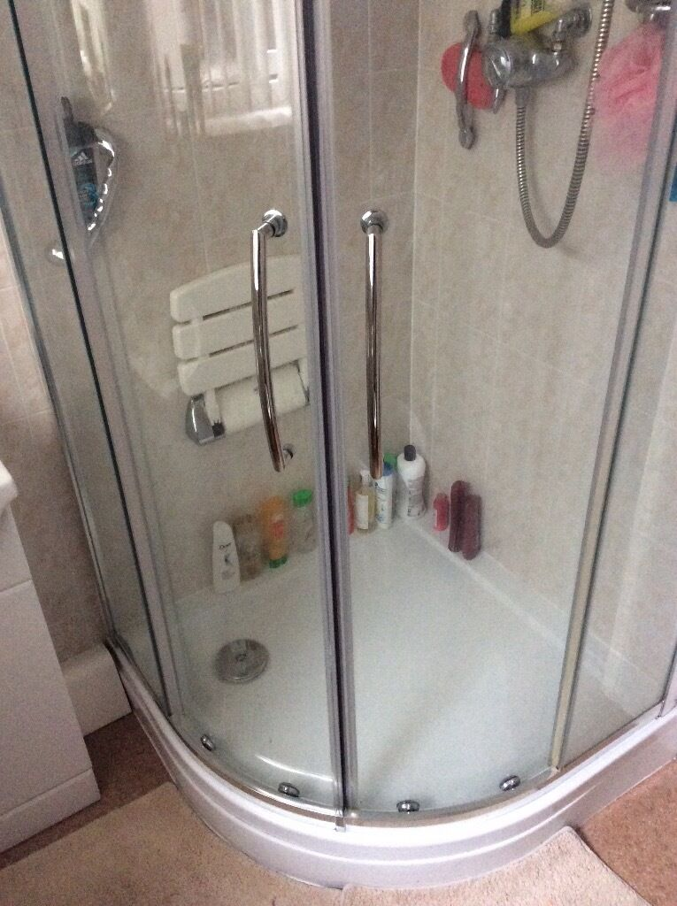 Shower cubicle with safety glass and ceramic tray with legs and seat ...