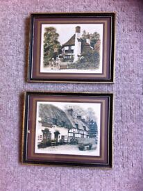 2 picture prints of ancient british pubs by A Jawtakumm 29cmx 24cm