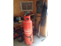 Workshop space heater and 47kg gas bottle and trolly