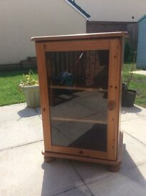 pine cabinet with glass front door