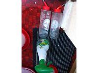 Guinea pig or rabbit water feeder pair and three quarter full bottle of disinfectant spray