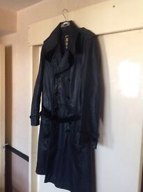 Men's full length double breasted real fine leather coat.