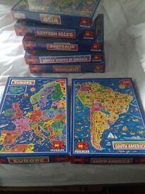 7x 500 piece jigsaws of around the world