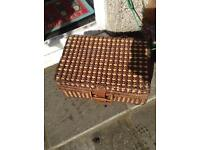 Traditional picnic hamper basket with plates etc