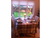 Wood and Glass Dining Table and 4 Cream Leather Chairs