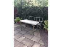 Rustic garden table and bench seat.