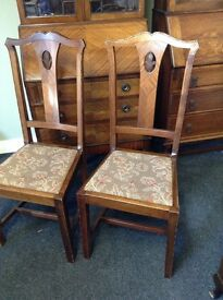 Matching pair of superb quality high backed chairs