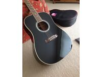 Great condition acoustic guitar with cover.