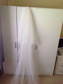 Full length white wedding veil