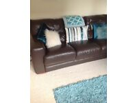 2 x 3 seater leather sofas originally from vogue in Glasgow £325 ovno