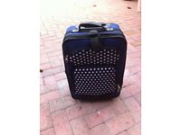 small navy blue spotted suitcase