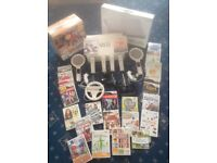 Nintendo wii package with accessories and games.