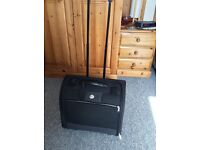 Black nylon cabin bag with wheels and telescopic handle