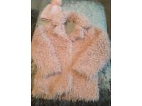 Girls pink fluffy jacket and hat age 8/9