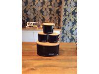 Black bread bin with matching tea, coffee, sugar pots