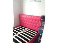 Pink faux leather bed