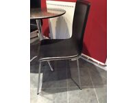 Round bistro table with 2 leather chairs