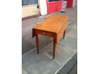 Country Pine Table , drop leaf sides. Pull out drawer on one side.