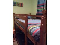Pine bunk beds, 5 drawer chest and side table, bedding, curtains, lamp shade and toy boxes matching
