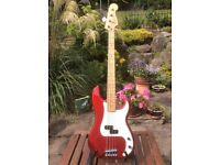 Fender Precision Bass. Made in Mexico. Candy Apple Red with maple neck.
