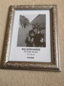 One 13 x 18 cm (5 x 7) Gold/Bronze Photo Frame. Brand new, never used.