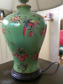Unusual table lamp decorated with flowers and birds