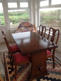 """Solid ash table and 4 oak chairs. Height 30""""' Width 29"""" and length 54"""""""