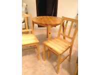 For Sale. Small wooden table and two matching chairs.