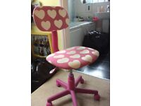 Pink heart chair on wheels