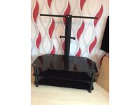Nearly new black glass TV stand for sale!