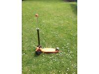 Maxi Micro Scooter in Orange with joystick single handlebar