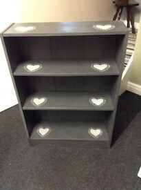 Bookcase storage display in grey with shabby chic heart detail
